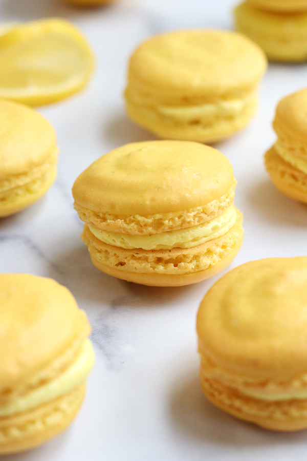 Several Lemon flavored Homemade Macarons lined up together.