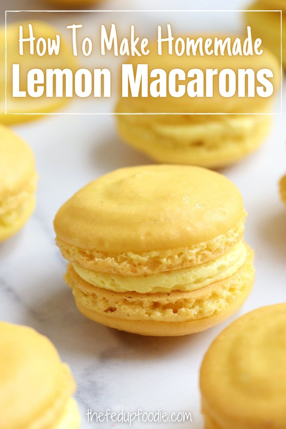 Lemon Macarons Recipe creates light and delicate textured cookies. These French style cookies are bursting with lemon flavor and have an irresistible filling combination of lemon buttercream and lemon curd or lemon buttercream and raspberry jam. The perfect cookie for baby showers, bridal showers or as a treat for lemon lovers. #LemonMacarons #LemonMacaronRecipe #LemonMacaronFilling #LemonMacaronsWithLemonCurd #HowToMakeMacaroons #HowToMakeMacarons #FrenchMacarons #MacaronsForBeginners