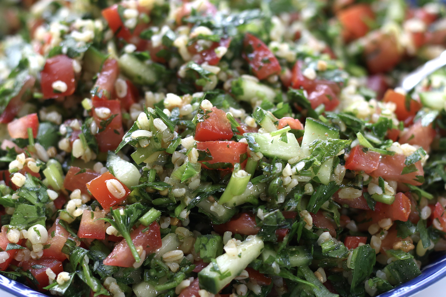 A very up close photo of Tabouleh with bulgar wheat.