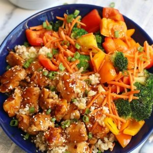 Overhead photo of Teriyaki Chicken Bowls recipe in a blue bowl.