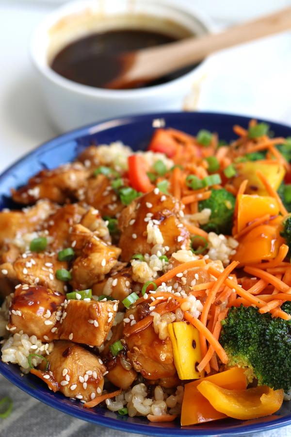 Teriyaki Rice Bowl sitting next to a small bowl of homemade teriyaki sauce.