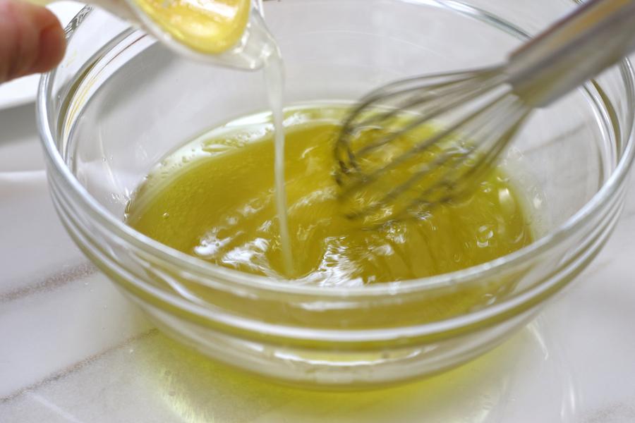 Whisking lemon juice into olive oil in making of vinaigrette for Tabouli Salad.