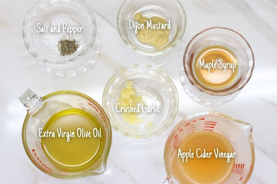 Ingredients for Apple Cider Vinegar Dressing in small bowls.