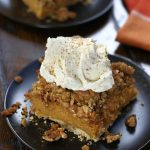 A square of Pumpkin Crisp with a big dollop of homemade whipped cream.