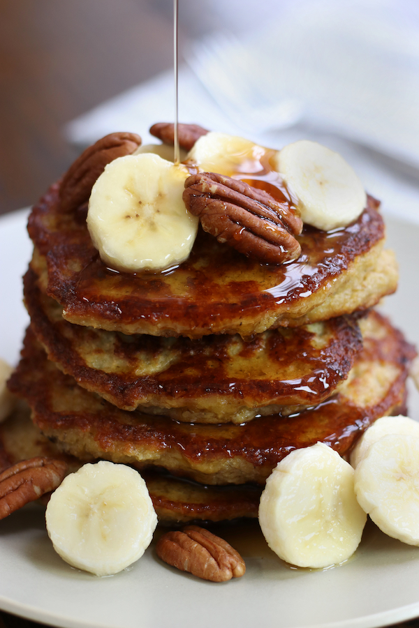 Banana and Oat Pancakes drizzled with maple syrup.