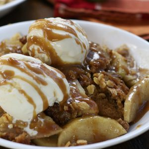 Old Fashioned Apple Crisp served in a white bowl.