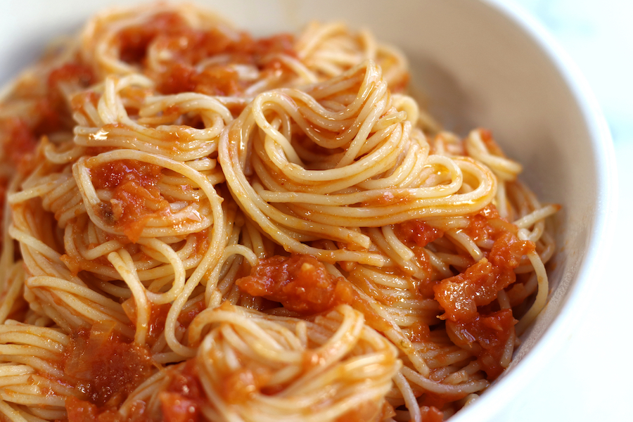 Pomodoro Sauce Recipe served in a white pasta bowl with angel hair pasta.