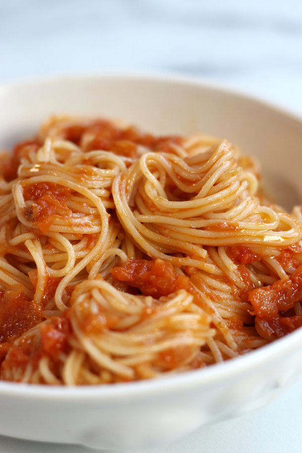 Angel hair pasta covered in Pomodoro Sauce.