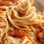Up close photo of Simple Pomodoro Sauce served over angel hair pasta.