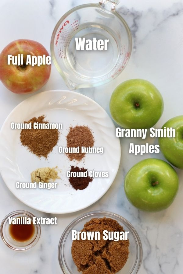Ingredients for Apple Compote on a white countertop.