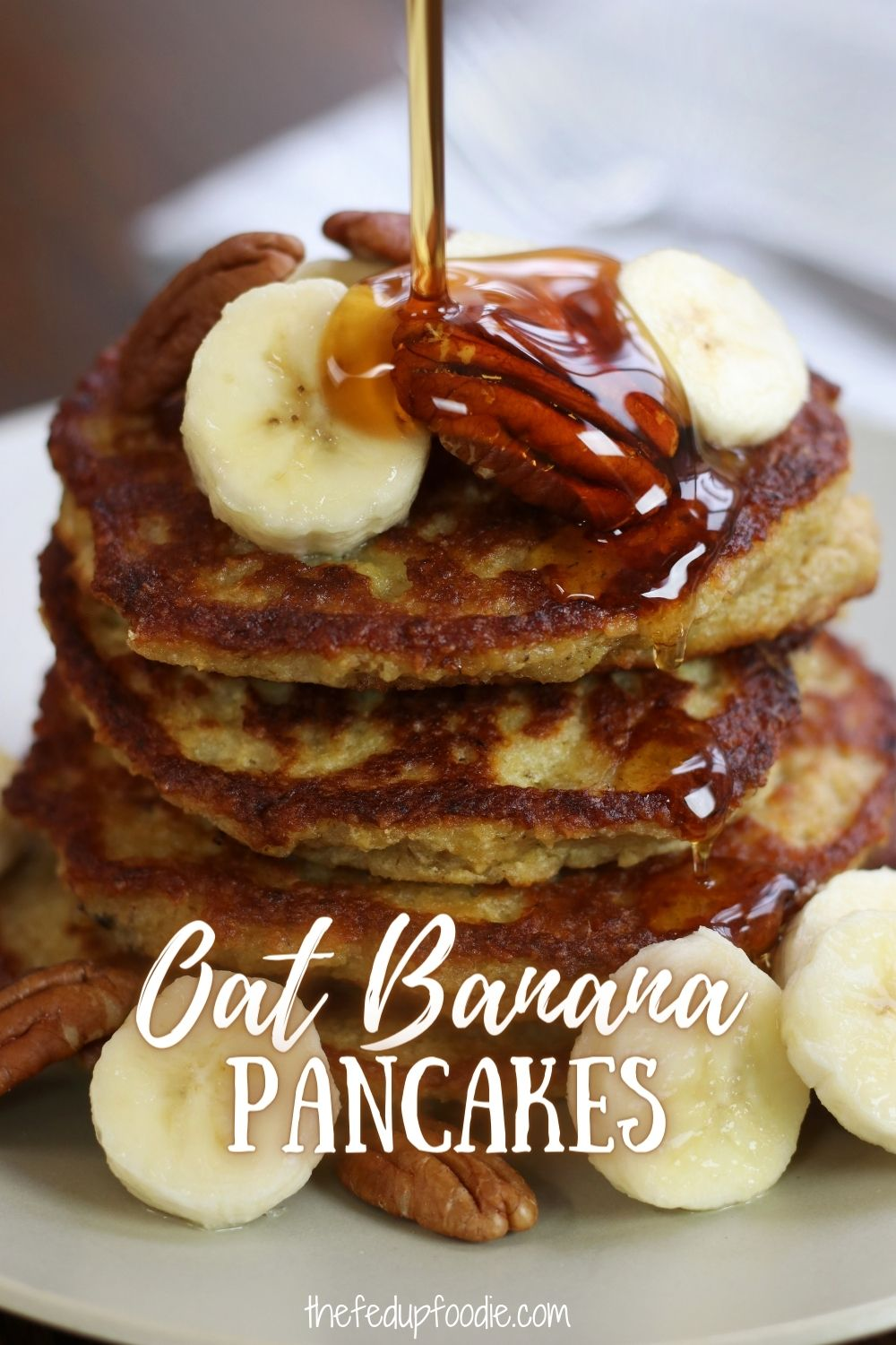 These Oat Banana Pancakes are not only healthy, they are also fluffy, tender and absolutely delicious. Easy to make and perfect for when you have over ripe bananas. Dairy free and vegan options included. #OatBananaPancakes #OatmealRecipesBreakfast #OatmealBananaPancakesHealthy #BananaOatmealPancakes #HealthyBananaOatPancakes